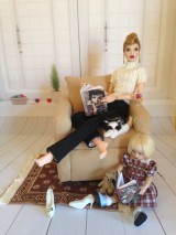 """Alma"" by Paul Pham and ""Riley"" by Helen Kish. Alma wears Stratus' wig, her original earrings, and a sweater and slacks by Tonner. Riley wears Boneka."
